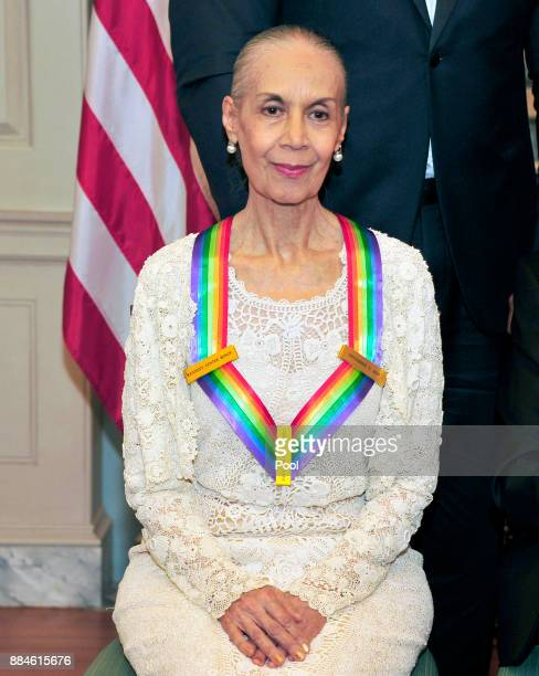 Carmen de Lavallade one of he five recipients of the 40th Annual Kennedy Center Honors with her award as she poses for a group photo following a...