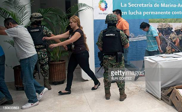 Carmen del Consuelo Saenz Marquez aka Claudia alleged financial operator of the Zetas drug cartel is escorted during her presentation to the press at...