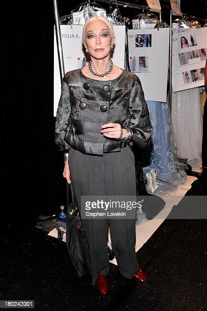 Carmen Dell'Orefice poses backstage at the Dennis Basso fashion show during MercedesBenz Fashion Week Spring 2014 at The Stage at Lincoln Center on...