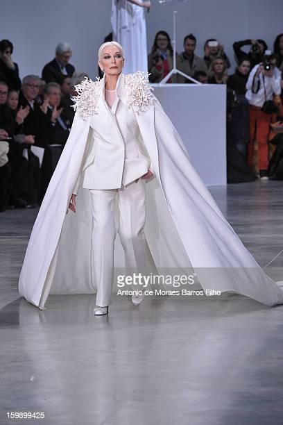 Carmen Dell'Orefice walks the runway during the Stephane Rolland Spring/Summer 2013 HauteCouture show as part of Paris Fashion Week at Palais De...