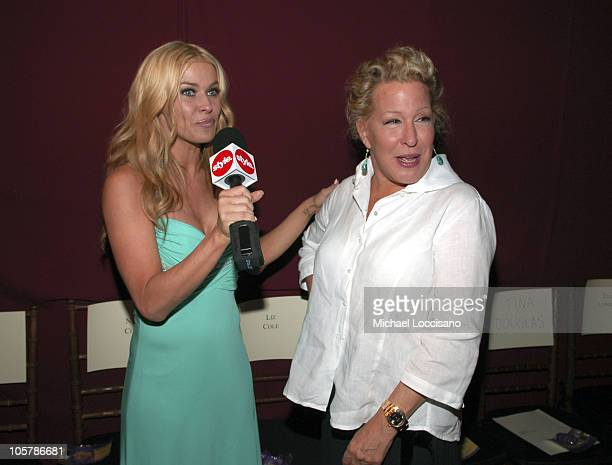 Carmen Electra and Bette Midler during Olympus Fashion Week Spring 2006 - Badgley Mischka - Front Row and Backstage at 261 11th Ave. In New York...