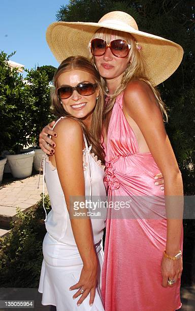 Carmen Electra and Kimberly Stewart during The Coach Luncheon to Benefit Peace Games at the Home of Quincy Jones at Quincy Jones' House in Beverly...