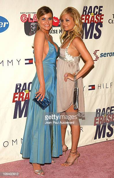 Carmen Electra and Nicole Richie during 11th Annual Race To Erase MS Gala Arrivals at The Westin Century Plaza Hotel in Los Angeles California United...
