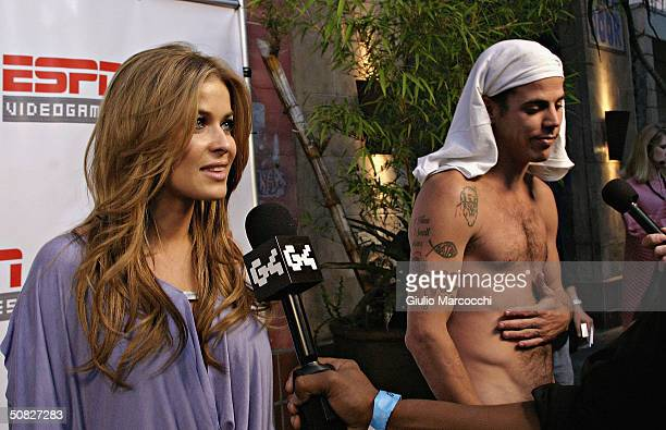 Carmen Electra and SteveO from Jackass attend The ESPN NFL 2005 For Xbox And PS2 Party on May 12 2004 at the Hotel Figueroa in Los Angeles California