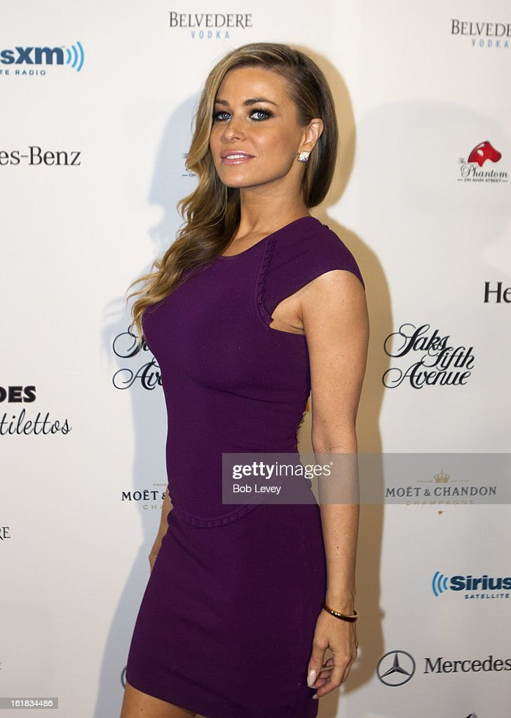 Carmen Electra arrives on the red carpet at Beverly Hills Sports And Entertainment Group Present The Event: Steel Toes And Stilettos Party at The Phantom on February 16, 2013 in Houston, Texas.
