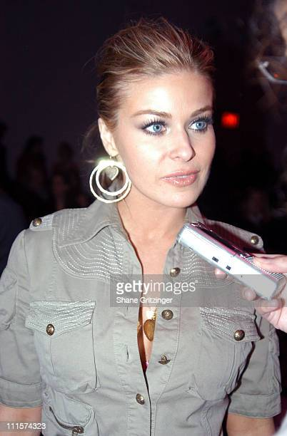 Carmen Electra during Olympus Fashion Week Fall 2005 Sass Bide Front Row and Backstage at The Plaza Bryant Park in New York City New York United...