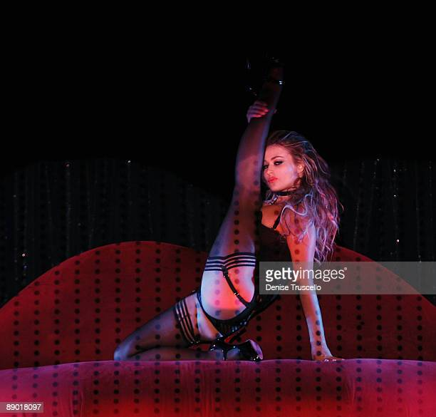 Carmen Electra performs in Crazy Horse Paris at the MGM Grand Hotel and Casino Resort on July 09 2009 in Las Vegas Nevada
