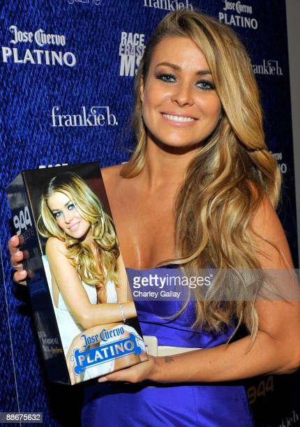 Carmen Electra poses with a custommade bottle of tequila at the Jose Cuervo Platino Penthouse with 944 Magazine at Andaz Hotel on June 24 2009 in...