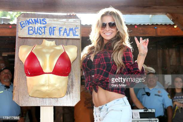 Carmen Electra unveils a cast of her own bust as she is inducted into the Bikinis Hall Of Fame at Bikinis TX on July 13 2013 in Fredericksburg Texas