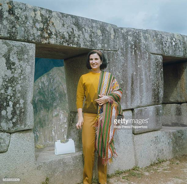 Carmen Franco daughter of General Francisco Franco of Spain pictured standing beside large carved interlocking stones at the Inca settlement of Machu...