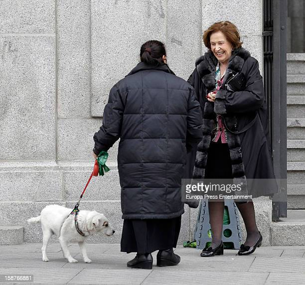 Carmen Franco is seen leaving a church and giving money to a beggar on December 27 2012 in Madrid Spain