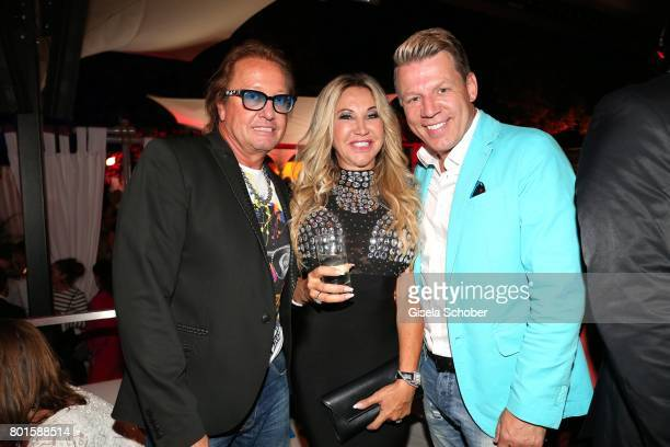 MUNICH GERMANY JUNE 26 Carmen Geiss and her husband Robert Geiss and Axel Kahn brother of Oli Kahn during the Movie meets Media Party during the...