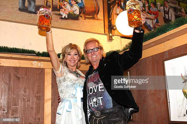 Carmen Geiss and her husband Robert Geiss attend the SonnenklarTV reception during Oktoberfest at Winzerer Faehndl/Theresienwiese on October 4 2014...