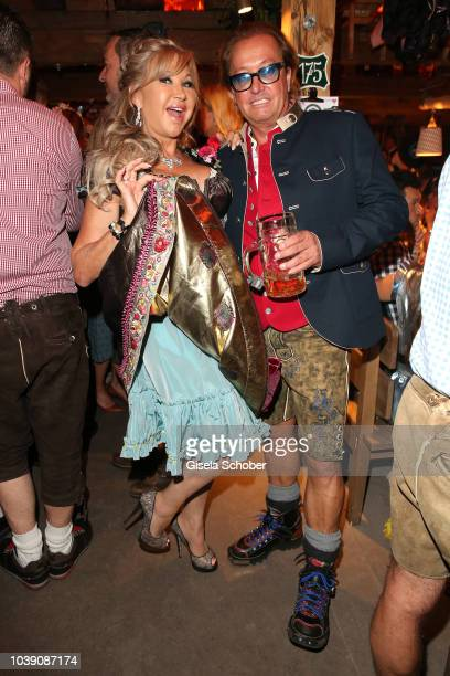 Carmen Geiss and her husband Robert Geiss during the 'Almauftrieb' as part of the Oktoberfest 2018 at Kaefer Tent at Theresienwiese on September 23...