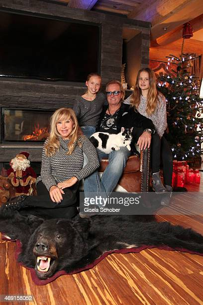 Carmen Geiss, Robert Geiss, daughter Davina Shakira and daughter Shania Tyra pose during a photo shooting in their house on December 13, 2014 in...