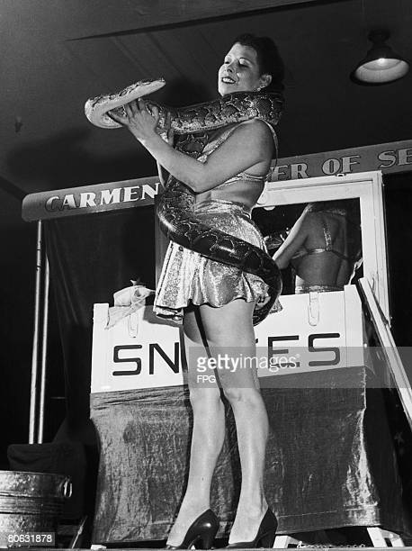 Carmen Gotterman 'Charmer of Serpents' performing with a python circa 1940