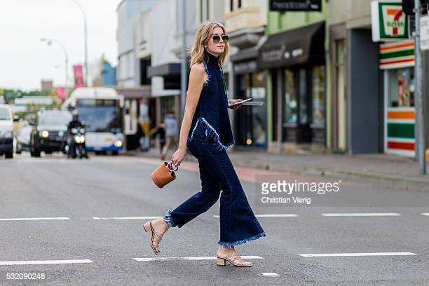 Carmen Hamilton wearing a navy denim jeans and sleeveless denim top from Marques Almeida outside Kitx at Mercedes-Benz Fashion Week Resort 17...