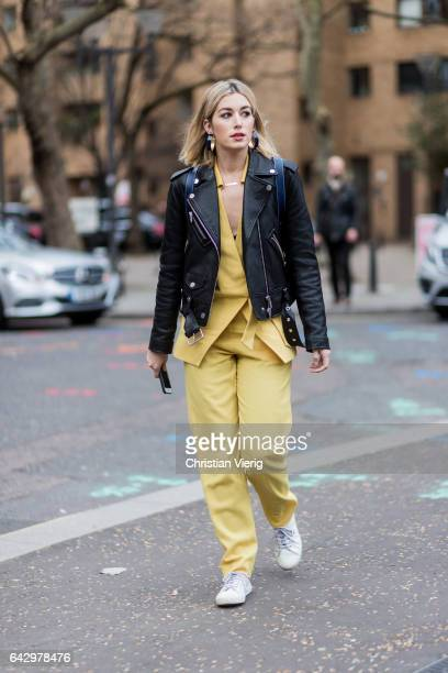 Carmen Hamilton wearing a yellow suit leather jacket outside Topshop Unique on day 3 of the London Fashion Week February 2017 collections on February...
