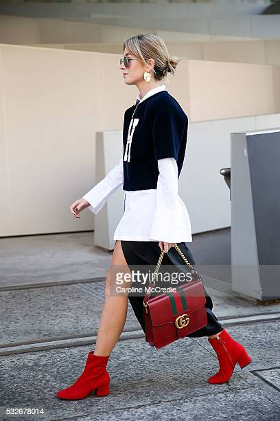 Carmen Hamilton wearing Tommy Hilfiger top and Gucci handbag arrives at MercedesBenz Fashion Week Resort 17 Collections at Carriageworks on May 19...