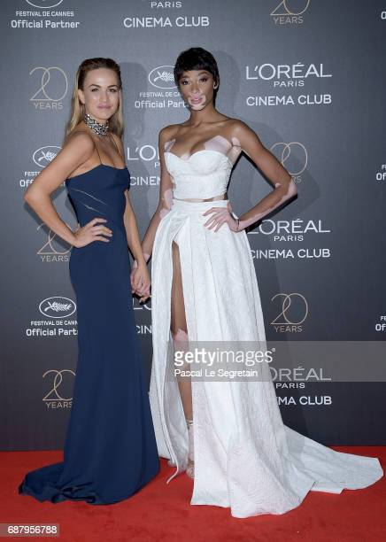 Carmen Jorda and Winnie Harlow attend the Gala 20th Birthday Of L'Oreal In Cannes during the 70th annual Cannes Film Festival at Martinez Hotel on...