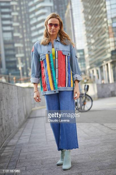 Carmen Jorda wearing Carrera sunglasses and Tommy Hilfiger total look is seen on Day 2 Milan Fashion Week Autumn/Winter 2019/20 on February 21 2019...