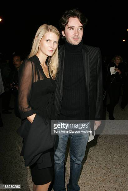 Carmen Kass and guest during Paris Fashion Week Pret a Porter Spring/Summer 2006 Christian Dior Arrivals at Grand Palais in Paris France