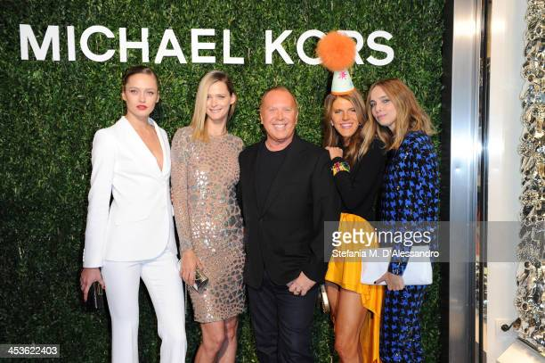 Carmen Kass Karmen Pedaru Michael Kors Anna Dello Russo and Candela Novembre attend Michael Kors To celebrate Milano opening on December 4 2013 in...