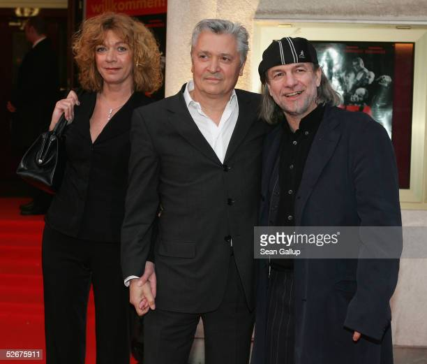 Carmen Kopplin actor Henry Huebchen and director Pepe Danquart arrive for the premiere of the German film Basta Rotwein oder Totsein April 21 2005 in...