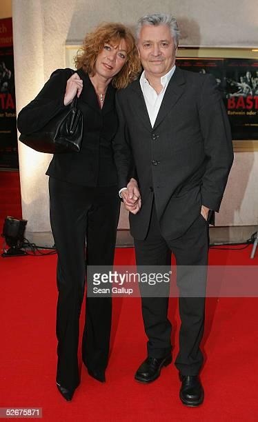 Carmen Kopplin and German actor Henry Huebchen arrive for the premiere of the German film Basta Rotwein oder Totsein April 21 2005 in Berlin Germany