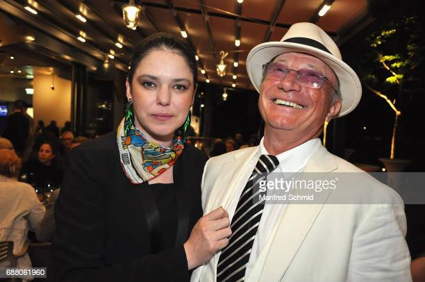 Carmen Kreutzer and Louie Austen pose during the 'Die Allee zum Genuss' restaurant opening party on May 24, 2017 in Vienna, Austria.