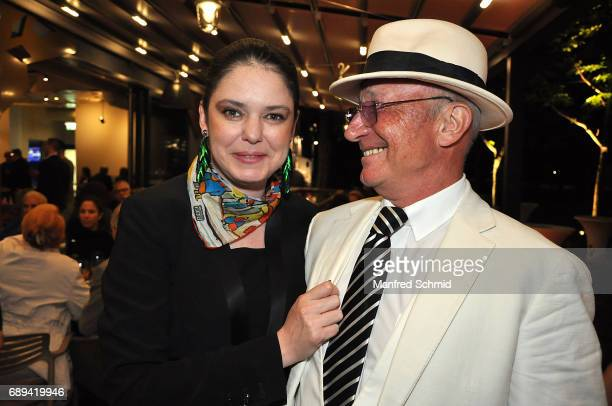 Carmen Kreutzer and Louie Austen pose during the 'Die Allee zum Genuss' restaurant opening party on May 24, 2017 in Vienna, Austria. On May 24, 2017...