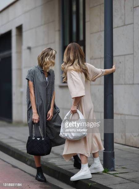 Carmen Kroll wearing rosé Acne Studios dress, white Bottega Veneta leather bag and white Copenhagen Studios boots and Justine Schlütter wearing...