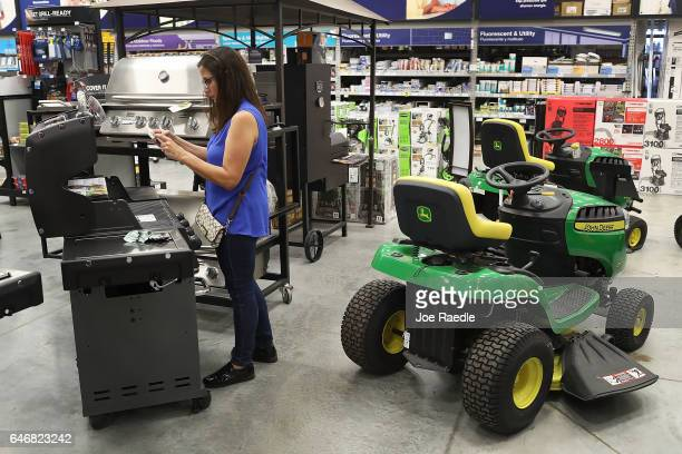 Carmen Ledesma shops for a BBQ grill at the Lowe's store on the day the company reported a rise in earnings on March 1 2017 in Hialeah Florida Lowe's...