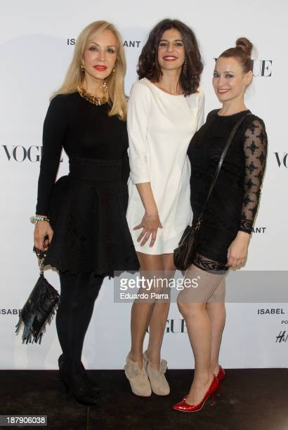 Carmen Lomana Critina Pena and Natalia Verbeke attend Isabel Marant new collection party photocall at HM store on November 13 2013 in Madrid Spain