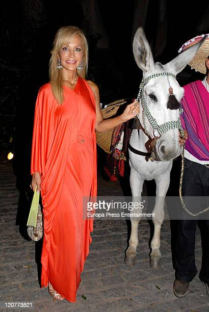 Carmen Lomana is seen with a donkey during a benefit party at the Marbella Club on August 09 2011 in Marbella Spain