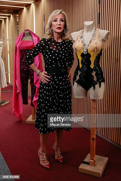 Carmen Lomana poses next to an original dress of Marilyn Monroe 'The Shopping Night Barcelona' at the Filmoteca de Catalunya Cinema on November 10...