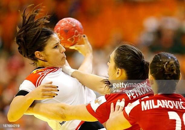Carmen Martin of Spain is challenged by Ivana Petkovic of Croatia during the Women's European Handball Championship 2012 Group C match between Spain...