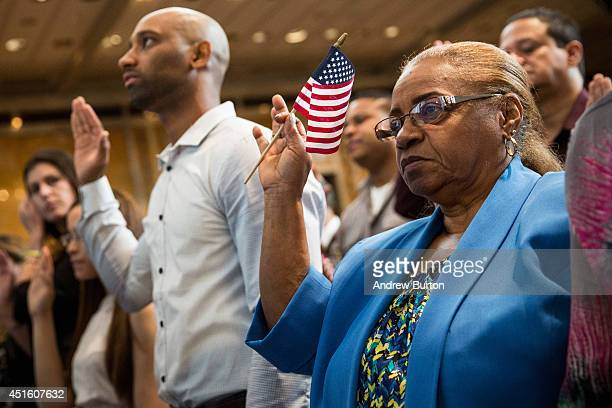 Carmen Mateo originally from the Dominican Republic takes part in an United States naturalization ceremony ahead of Indepedence Day at the New York...