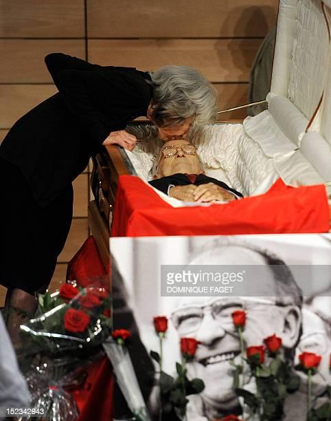 Carmen Menendez kisses the body of her husband Spain's former Communist Party leader Santiago Carrillo at a funeral chapel in Madrid on September 19...