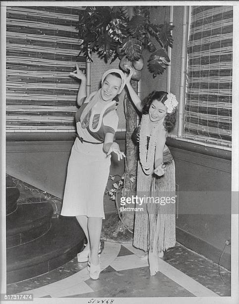 Carmen Miranda Brazilian singing star of the current Broadway hit Streets of Paris learning the intricacies of the hula from Meymo Holt featured...