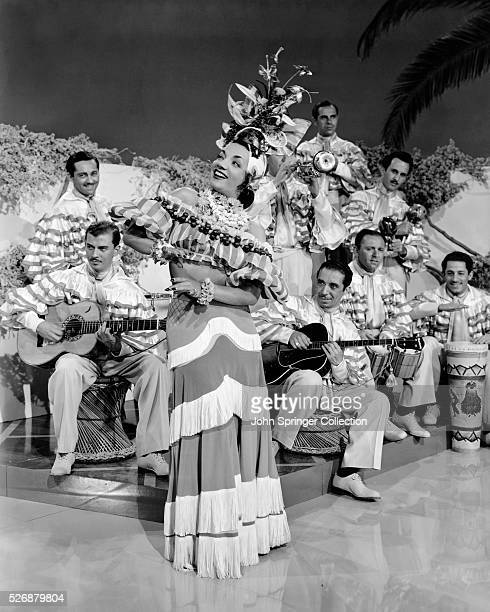 Carmen Miranda in the role of Rosita Rivas dances to the music of a band in the 1941 film WeekEnd in Havana