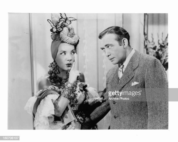 Carmen Miranda pointing her finger in front of Phil Baker in a scene from the film 'The Gang's All Here' 1943