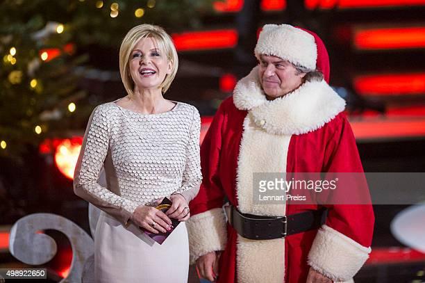 Carmen Nebel and Andy Borg as Santa Borg present the 'Heiligabend mit Carmen Nebel' TV show at Bavaria Filmstudios on November 26 2015 in Munich...