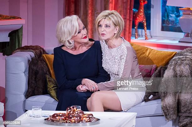 Carmen Nebel and Angelika Milster attend the 'Heiligabend mit Carmen Nebel' TV show at Bavaria Filmstudios on November 26 2015 in Munich Germany