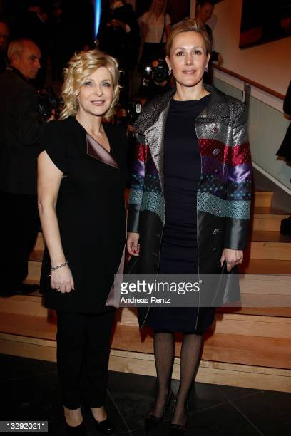 Carmen Nebel and German First Lady Bettina Wulff arrive for the Goldene Erbse Award 2011 at Estrel Hotel on November 15 2011 in Berlin Germany