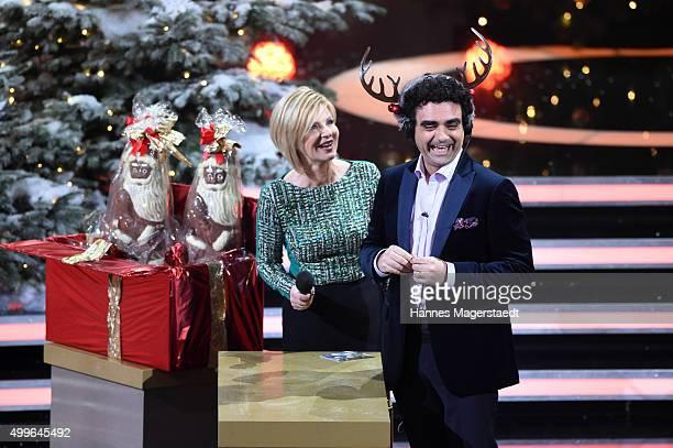 Carmen Nebel and Rolando Villazon during the 'Die schoensten Weinachtshits' TV Show at Bavaria Filmstudios on December 2 2015 in Munich Germany