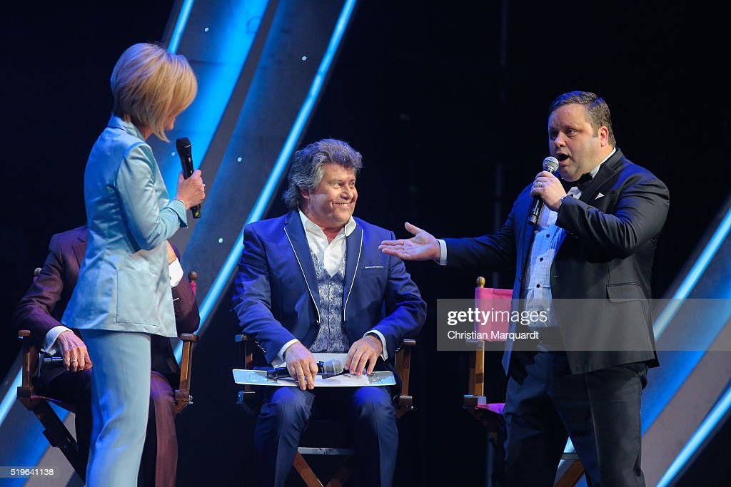 Carmen Nebel, Andy Borg and Paul Potts perform on stage during the tv show 'Willkommen bei Carmen Nebel' at Tempodrom on April 7, 2016 in Berlin, Germany.
