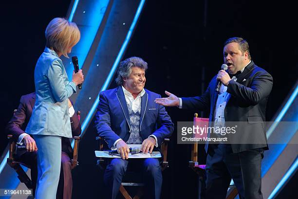 Carmen Nebel, Andy Borg and Paul Potts perform on stage during the tv show 'Willkommen bei Carmen Nebel' at Tempodrom on April 7, 2016 in Berlin,...