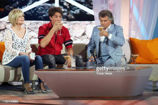 Carmen Nebel Matze Knop and Andy Borg during the television show Willkommen bei Carmen Nebel at BadenArena on July 13 2019 in Offenburg Germany
