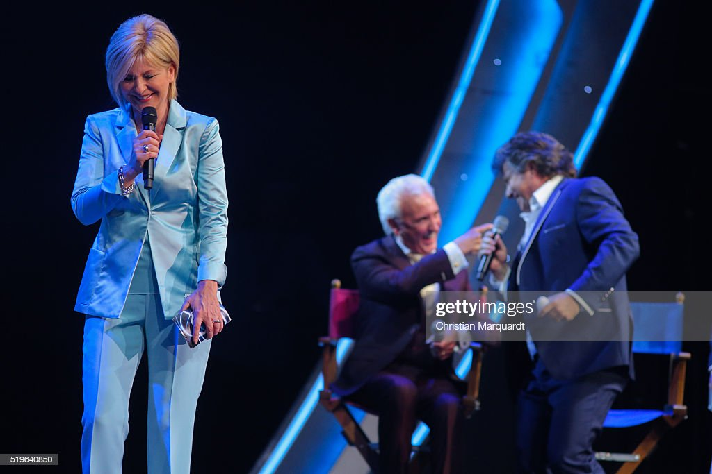 Carmen Nebel, Tony Christie and Andy Borg perform on stage during the tv show 'Willkommen bei Carmen Nebel' at Tempodrom on April 7, 2016 in Berlin, Germany.